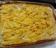 Πατάτες με καπνιστό χοιρινό, τυρί και γιαούρτι στο φούρνο