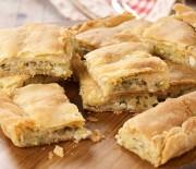 Πίτα με κολοκυθάκια ανθότυρο και μυρωδικά