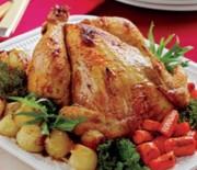 Κοτόπουλο γεμιστό με κουκουνάρι και σπανάκι στο φούρνο