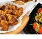 Παϊδάκια κοτόπουλου στο φούρνο με πατάτες σωτέ και πιπεριές γεμιστές